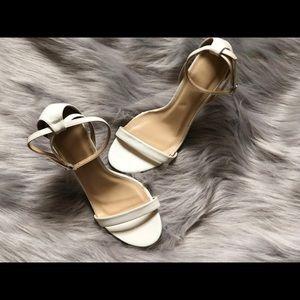 All white single sole stilettos